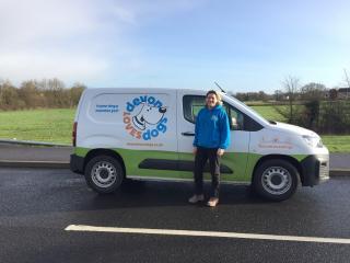 Julie standing next to her van