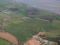 An aerial photo of green fields next to the Exe Estuary which will become Dawlish Countryside Park